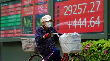 Asian stocks mostly higher on hopes for pandemic recovery