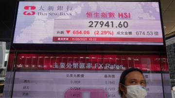 Asian shares slide after tech sell-off on Wall Street