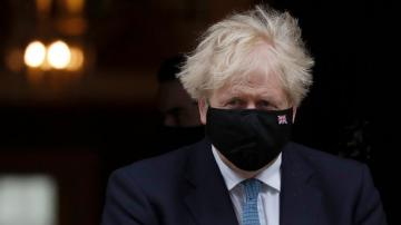 UK's Johnson backs public inquiry into handling of pandemic