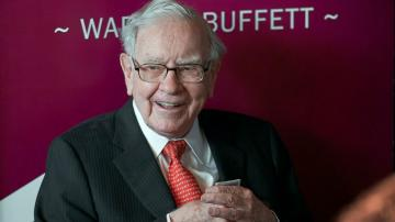 Buffett's firm sells off financials, halves Chevron stake