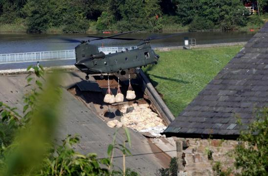 British military drop ballast sacks on dam to prevent flooding of Whaley Bridge