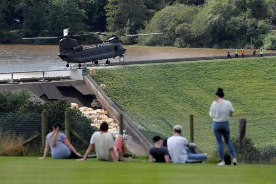 British military called in to stop dam collapsing and flooding town