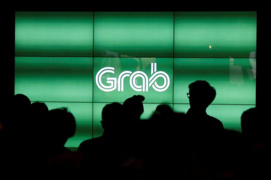 SoftBank-backed ride-hailing firm Grab announces layoffs