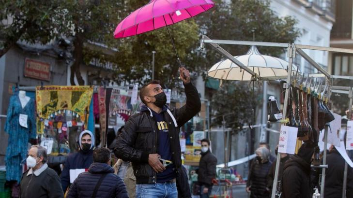 Ancient Madrid market reopens amid debate over virus rules
