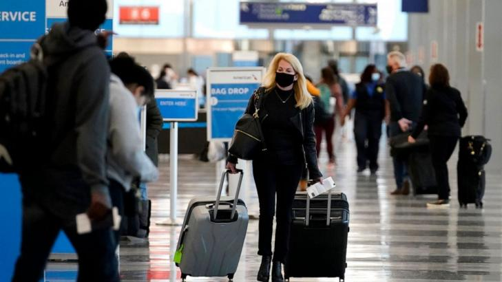 Holiday air travel surges despite dire health warnings