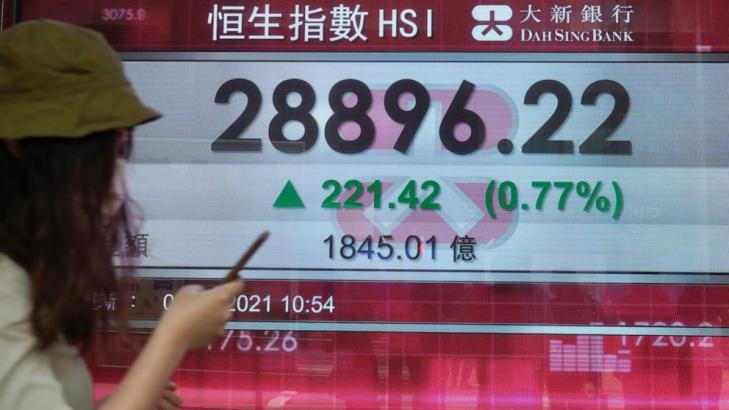 Asian shares mostly higher; Tokyo slips as virus cases surge